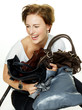 Woman has fun to adhere her bags