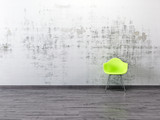 Fototapety Alte gestrichene Wand grüner Stuhl Parkett