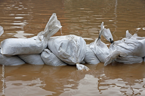 sandbags for flood defense and brown water