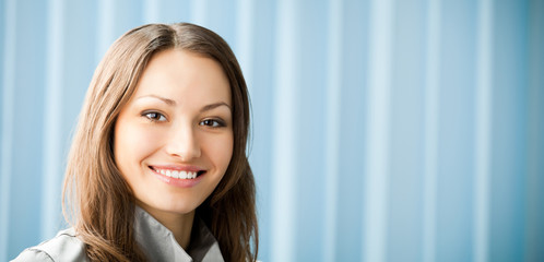 Young cheerful smiling businesswoman