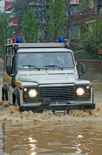 rescue car in a way flooded during a flood