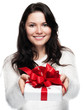 Young woman hands over a gift - isolated