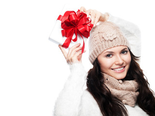 Pretty young woman holding gift about her head with 2 hands