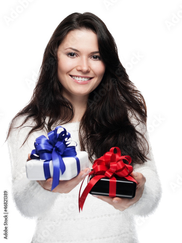 Young woman hands over two gifts - isolated