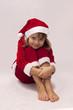 Dziewczynka w stroju Mikołaja