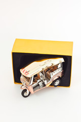 Golden Tuk tuk car with yellow box
