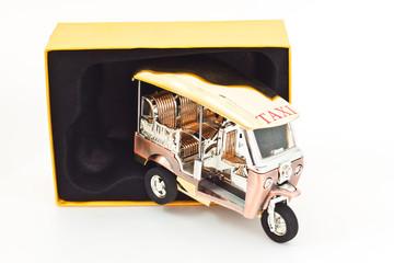Golden Tuk tuk car with yellow box