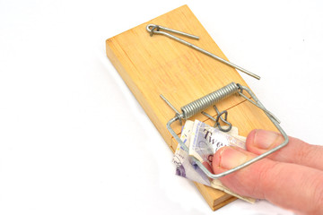 fingers trapped in mousetrap grabbing money
