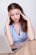 Woman crumpling paper in frustration