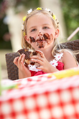 Messy Girl Eating Chocolate Cake