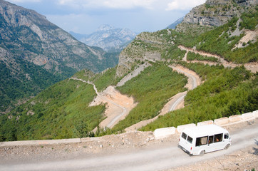 Minibus, Winding Road And Albanian Mountains