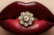 Macro lips cherry make-up with wedding gold diamond ring