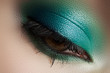 Elegance close-up of female eye with mint color eyeshadow