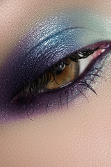 Close-up of female eye with bright sky-blue eyeshadow