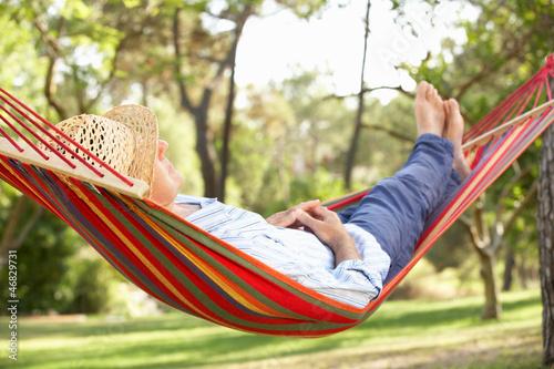Leinwanddruck Bild Senior Man Relaxing In Hammock