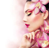 Fototapety Beautiful Girl With Orchid Flowers. Perfect Make-up