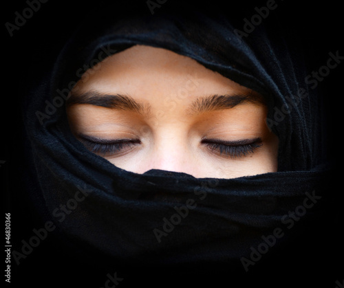 Portait of woman wearing scarf with eyes closed