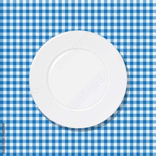 Plate on blue tablecloth