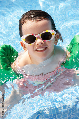 Portrait Of Girl With Armbands In Swimming Pool