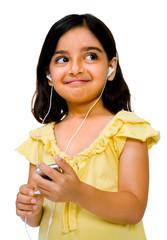 Close-up of girl listening music