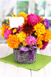 Beautiful bouquet of bright flowers with paper note