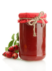 jar with hip roses jam and ripe berries, isolated on white