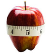 Close-up of measuring tape wrapped around apple