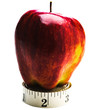 Apple on roll of measuring tape