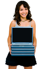 Latin American teenage girl holding laptops