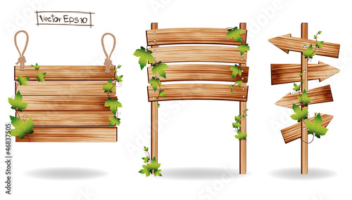 Vector Wooden signs with green leaves