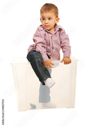Boy coming out from box