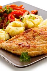 Pork chops, mashed potatoes and vegetable salad
