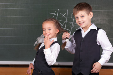 Portrait of schoolchildren near a blackboard