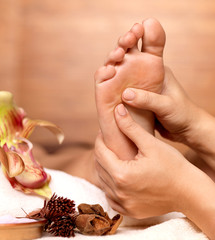 Massage of human foot in spa salon