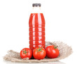 Tomato juice in bottle on sackcloth isolated on white