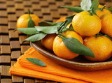 ripe juicy tangerine, orange mandarin  with leaves