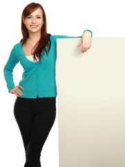 Portrait of a casual young woman holding blank card