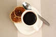 Cup of coffee on brown background