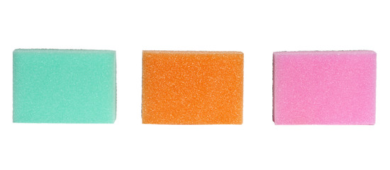 three colorful sponges on white background