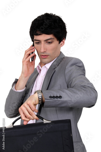 Businessman trying to stay on schedule