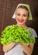 Happy smiling woman cook holding salad, close-up