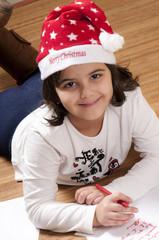 bambina che scrive a babbo natale