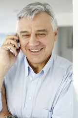 Aged man talking on mobile phone