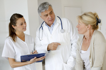Medical people giving prescription to patient