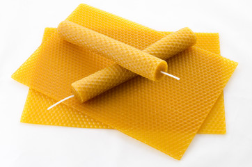 two Candle made of beeswax on honeycomb - background