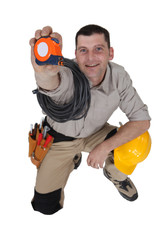 Man holding up a measuring tape
