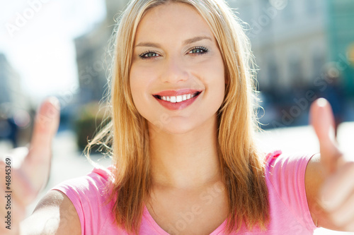 Attractive woman giving thumbs up