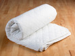 white mattress protection on wooden background - 46846941