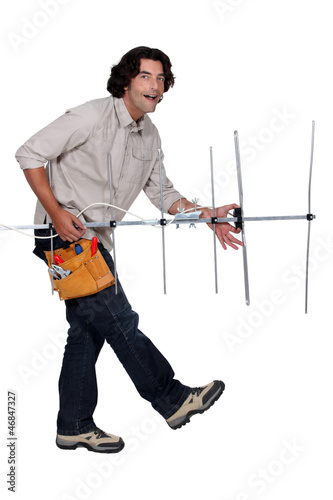 Repairman playing air guitar with a television aerial