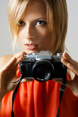 Beautiful Woman Holding Camera